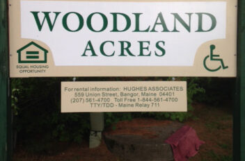 Woodland Acres Housing sign
