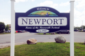 Newport town-line signs